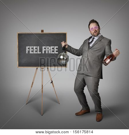 Feel free text on  blackboard with drunk businessman