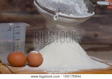 Sift the flour through a sieve. to prepare the dough for baking
