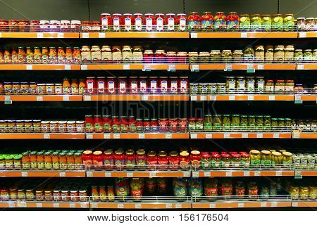 Chernihiv / Ukraine. 06 March 2016:store canned of cucumbers tomatoes and others on the counter of supermarket. 06 March 2016 in Chernihiv