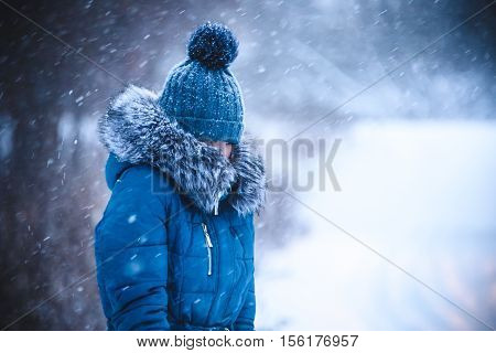 girl has muffled in a warm collar from a blizzard