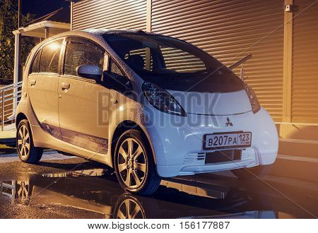 Sochi, Russia - October 09, 2016: Mitsubishi MiEV parked on the street at night. Mitsubishi innovative Electric Vehicle.