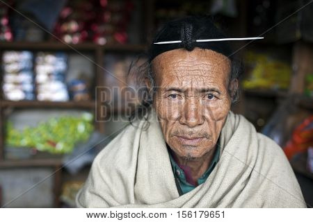 ZIRO, ARUNACHAL PRADESH/INDIA - DECEMBER 13, 2013: Man of the Apatani tribe. The Apatani are a tribal group of people living in the Ziro valley in Arunachal Pradesh, India.