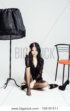 Sexy Woman With Lamp And Chair