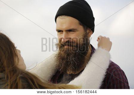 Pretty Girl Holds Bearded Man