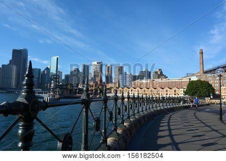 Urban Landscape View Of The Rocks And Modern Sydney Skyline