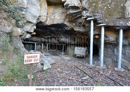 Entrance to a old coal and kerosene shale mines in Katoomba Jamison Valley at Blue Mountains New South Wales Australia.