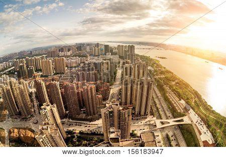 Aerial Cityscape at dusk China Nanchang buildings and rivers.