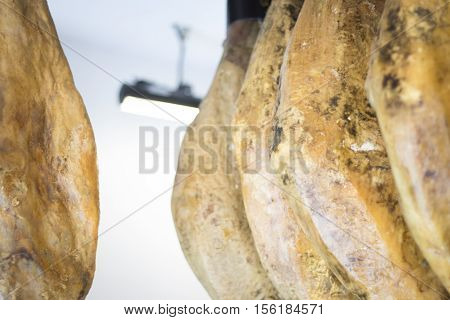 Spanish Iberian cured ham cutun for stored for slices of cold meat in delicatessan.