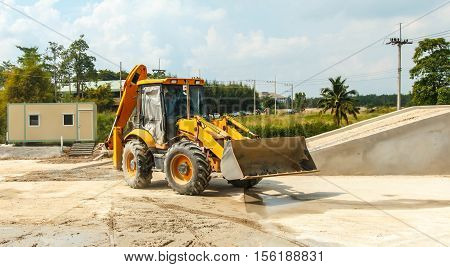 wheel loader yellow excavator earthmoving Outdoors cement.