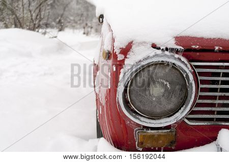 Cropped shot of a car stuck deep in snow. Outdoor shot with focus in the foreground