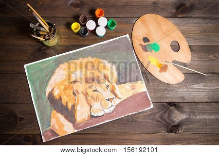 lion drawing gouache, dark wooden table, brushes and palette, paints, draw, experience