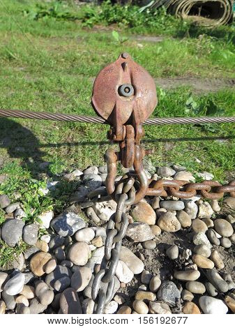 Winch cable pulley and chain for beaching boats on Beer Beach Devon UK