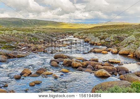 River Acroos The Hardangervidda Plateau In Hordaland, Norway