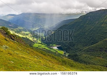 Rain over a valley in the region of Hordaland,  Norway