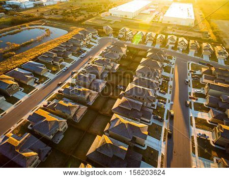 Epic Sunrise High Aerial Above Austin Texas Round Rock Suburbia Houses in simple rows and lines all the exact same a new housing development in Central Texas