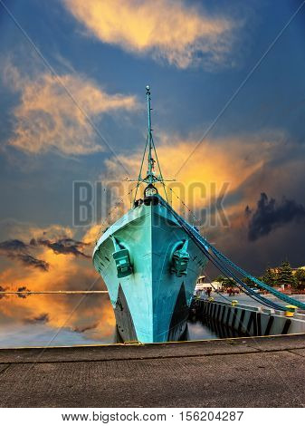 Warship at sunset in the port of Gdynia Poland.