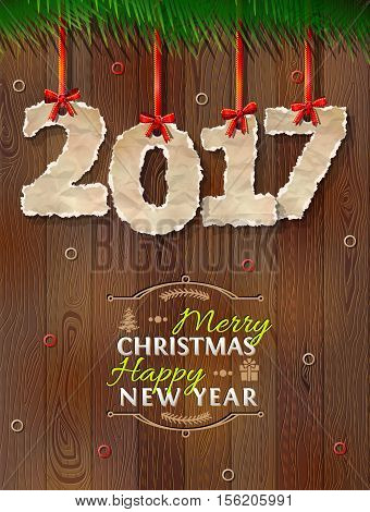 New Year 2017 of crumpled paper against wood background. Paper numbers with torn edge on ribbon. Vector illustration for new years day christmas winter holiday new years eve silvester etc