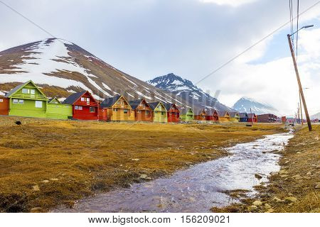 Colorful wooden houses at Longyearbyen in Svalbard. Summer in the arctic environment of Longyearcity