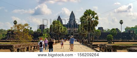 Siem Reap, Cambodia - February 1, 2016: Unidentified tourists visit to main entrance of Angkor Wat temple Siem Reap Cambodia. The largest religious monument in the world.