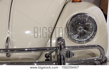 Gdansk, Poland - November 12, 2016: The front bumper and the lights of the famous German Volkswagen Beetle 1967