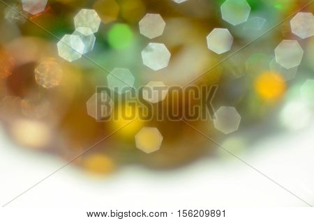 Festive soft warm colors out of focus abstract background. First plan is snowy white.