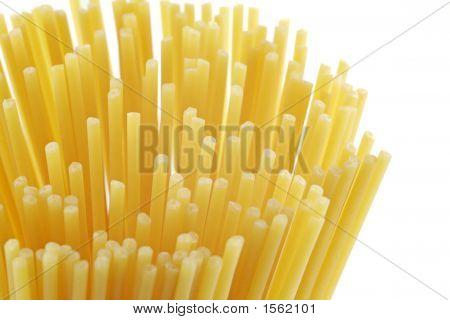 Uncooked Spaghetti Pasta On White Background