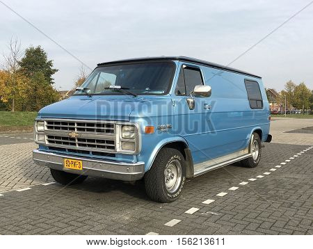 Almere Stad, Flevoland, The Netherlands - November 12, 2016: Blue Chevrolet Chevy Van 20 parked on a public parking spot in the city of Almere. nobody in the vehicle.