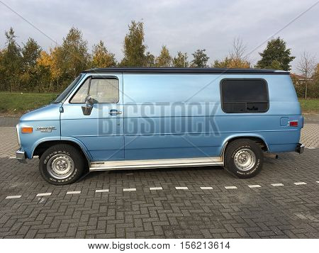 Almere Stad, Flevoland, The Netherlands - November 12, 2016: Blue Blue Chevrolet Chevy Van 20 parked on a public parking spot in the city of Almere. nobody in the vehicle.