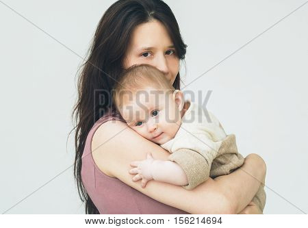 Baby With Mother. Studio Shot. Isolated On White.