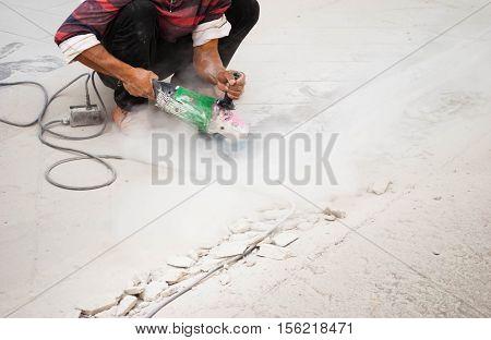 Labor Using Machine Cutting Concrete Smooth