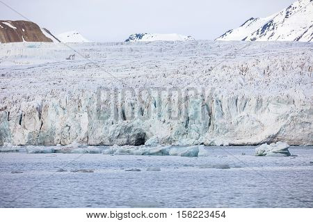 Close-up of the large and massive Borebreen glacier from the sea. Arctic environment in Oscar II Land at Spitsbergen, Svalbard. Melting ice and global warming.