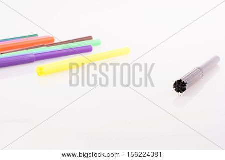 Color felt-tip pens of various color on white background