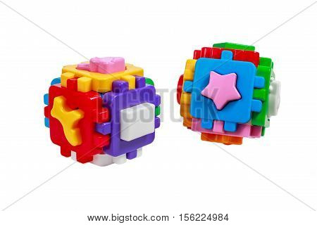 Toy colorful cubes with interlocking parts, sorter, attaching pieces