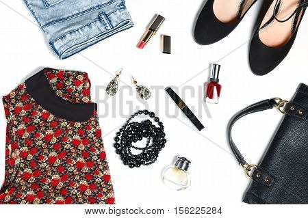 Modern woman clothes and look essentials - silk blouse, jeans, black high heels, black leather bag, red lipstick, perfume