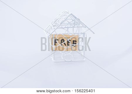 The word HELP and a model house