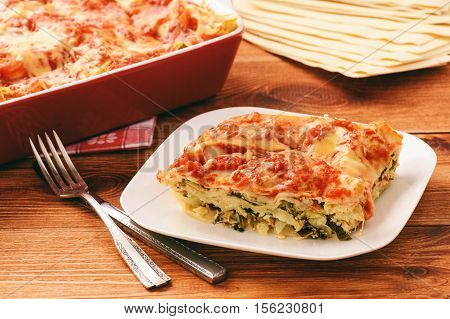 Lasagna with spinach, ricotta and feta .