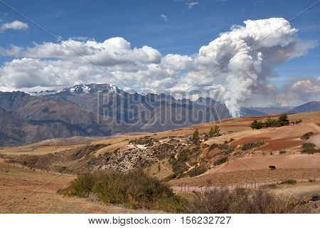 The fire and heavy smoke in the Urubamba mountain range in the Cusco Region in Peru