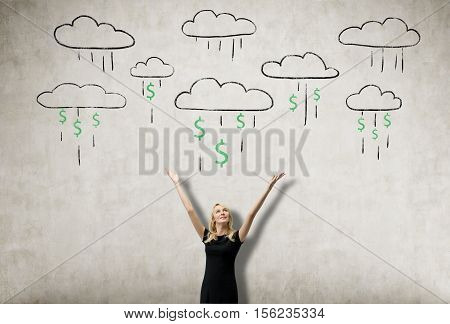 Portrait of blond woman wearing black dress and standing near concrete wall with dollar clouds pouring the rain on her. Concept of making money