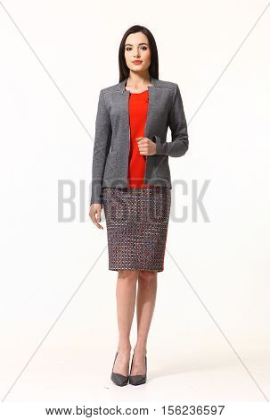 woman with straight hair style in blue official gray power suit skirt and jacket high heels shoes full length body portrait standing isolated on white
