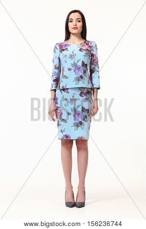 woman with straight hair style in two pieces jacket and skirt blue print floral suit high heels shoes full length body portrait standing isolated on white