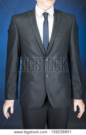 Men classic suit, shirt and tie on a mannequin