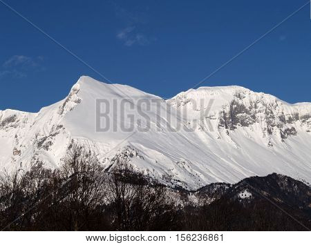 A snow covered Mnt. Krn with blue sky, Slovenia