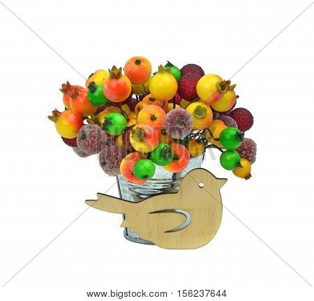 Wooden handmade bird sits near a bucket of froze nberries. festive  decor. Christmas. Easter. Spring. Winter. / isolated on white background without shadows /. Close-up.
