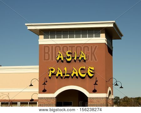 RIVER FALLS,WISCONSIN-NOVEMBER 12,2016: The Asia Palace sign and storefront. Asia Palace serves Chinese,Tha,iVietnamese,and Japanese cuisines.