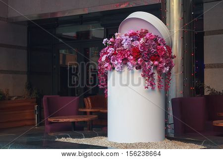 Basket with artificial flowers at the entrance to the hotel