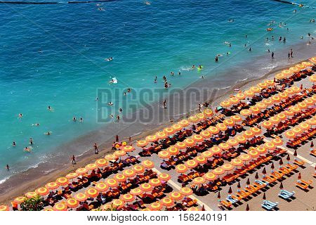 A long beach with chrystal clear water in Positano, Italy.