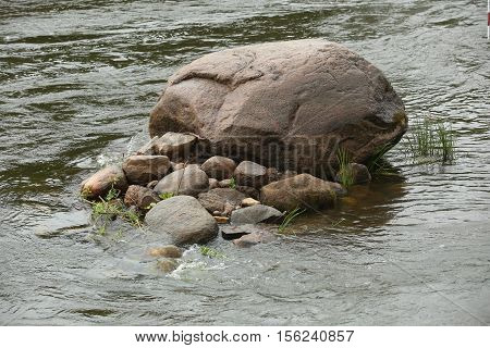 Huge Stone In The River
