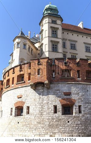 KRAKOW POLAND - JUNE 30 2016: Wawel Royal Castle with defensive wall. Wawel Royal Castle In Cracow In Poland was since the 14th century was the residence of Polish kings and place of their coronation. It is the greatest architectural monument in Poland in