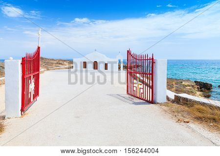 Agios Nikolaos. Open Gate And White Church