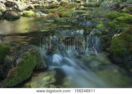 Wood River in summer passing by the term of Paterna del Madera Albacete Spain. Horizontal capture with green